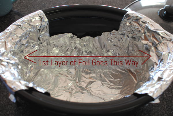 First layer of foil Slow Cooker Mexican Lasagna